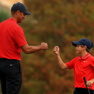 Tiger Golfs with Son